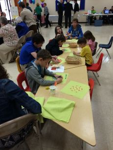 Kids making quilt squares