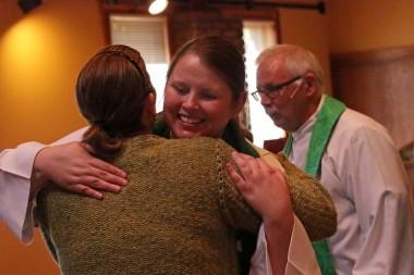 Pastor Kristin hugs her sister