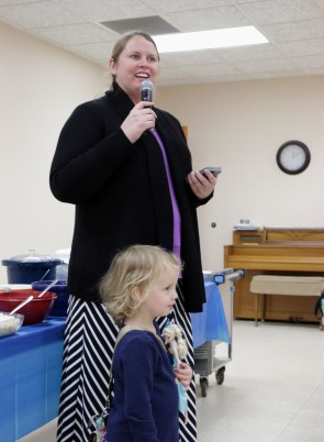 Pastor Kristin says grace.