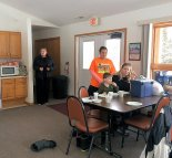 Folks enjoying the warm cabin
