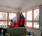 Folks enjoying the warmth of the cabin