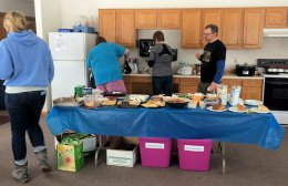 People get potluck ready to eat!